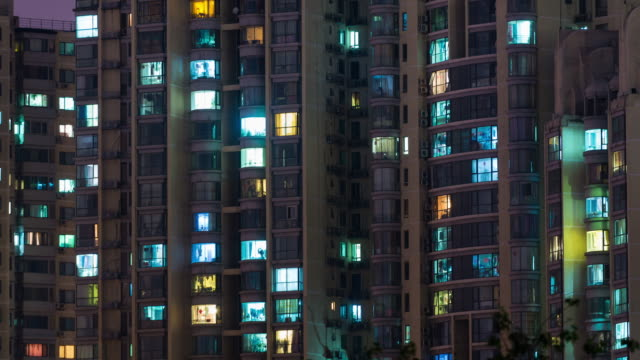 time lapse- grid apartment in beijing (cu pan) - luce stradale video stock e b–roll