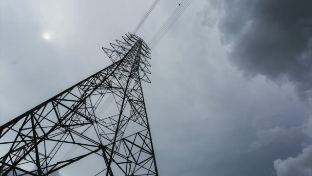 Time Lapse High voltage power tower, Electrical pole structure with cloudy moving on sky.