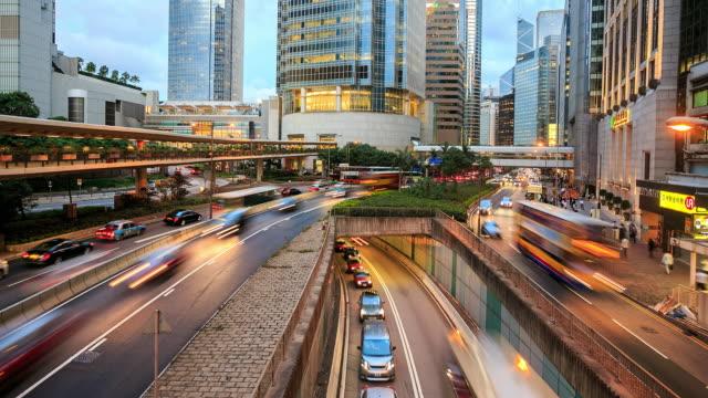 4k time lapse : hong kong central business district - время дня стоковые видео и кадры b-roll
