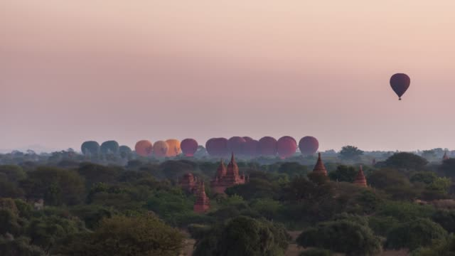 4K Time lapse : Hot Balloons flying over Bagan Temples ,Old Pagoda in Bagan Myanmar 4K Time lapse : Hot Balloons flying over Bagan Temples ,Old Pagoda in Bagan Myanmar bagan stock videos & royalty-free footage