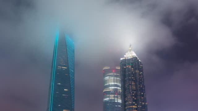 Time Lapse- Illuminated Skyscrapers in Shanghai at night in foggy weather (CU LA LR Pan) video