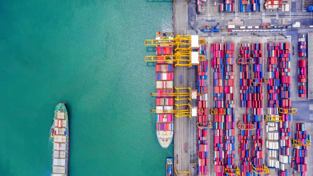 4K, Time lapse  industrial port with containers from top view or aerial view. It is an import and export cargo port where is a part of shipping dock and export products worldwide