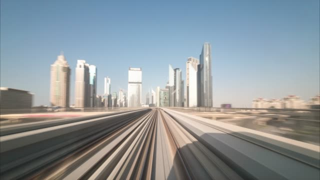 Time lapse journey on the modern driverless Dubai elevated Rail Metro System, running forward alongside the Sheikh Zayed Road