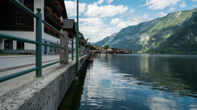 time lapse, landscape and crowd visiting at hallstatt village, austria - neoclassical architecture stock videos & royalty-free footage