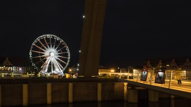 Time lapse loop of the lifted bridge and ferris wheel at night in Gdansk Time lapse loop of the lifted bridge and ferris wheel at night in Gdansk, Poland gdansk stock videos & royalty-free footage