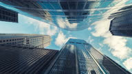 istock Time lapse Low angle of tall corporate buildings skyscraper 1298283535