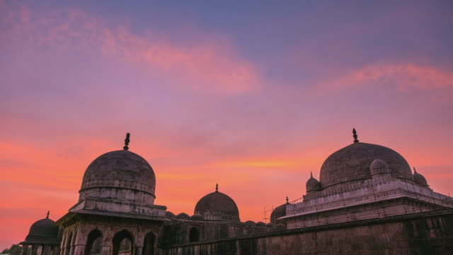 time lapse mandu india, afghan ruins of islam kingdom, mosque monument and muslim tomb. colorful sky at sunrise. - madhya pradesh filmów i materiałów b-roll