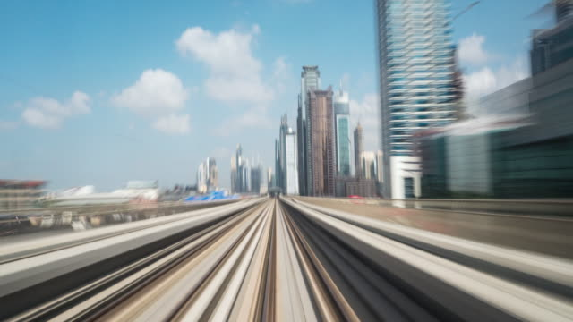 time lapse metro riding through downtown dubai - dubai architecture stock videos & royalty-free footage