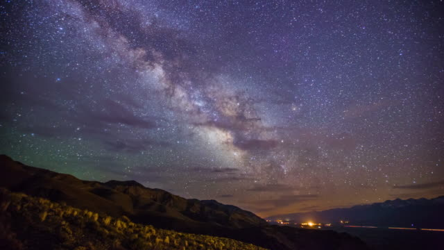 Time Lapse - Milky Way Galaxy Over Mountain Range with Beautiful Clouds - 4K video