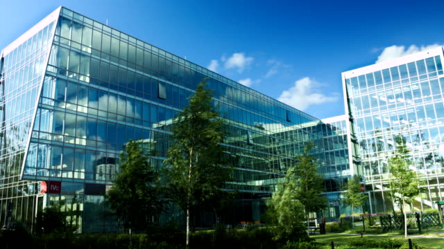 Time lapse modern office building and clouds establishing shot video