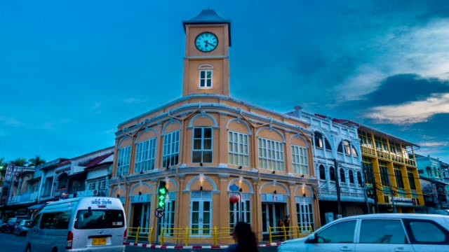 time lapse motion at intersection old building - phuket video stock e b–roll