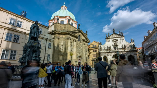 Time Lapse Movie of People Tourist Walking at St. Francis Of Assisi Church and Charles Bridge, Prague, Czech Republics