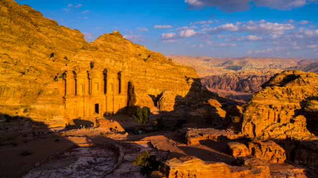 time lapse movie sunset and moving cloud of panoramic scene of the monastery in ancient city of petra, jordan - antica civiltà video stock e b–roll