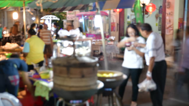 4k time lapse movie thai local vendors selling food and clothes at famous sunday night market in songkhla old town. tourists walking and shopping. songkhla, thailand - phuket video stock e b–roll