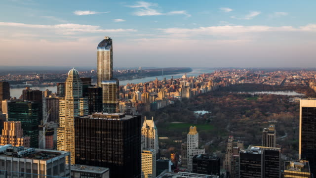 Time Lapse: New York Central Park Time lapse of New York City skyline with Central Park surrounded by skyscrapers. central park manhattan stock videos & royalty-free footage