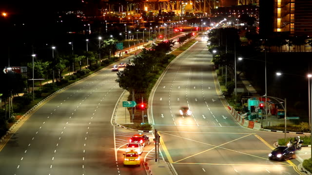 Time Lapse: Night traffic at urban road in Singapore City video