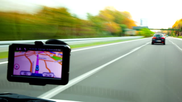 Time lapse of a car driving Time lapse of a car driving with gps navigation global positioning system stock videos & royalty-free footage