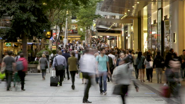 Time lapse of a crowd in a mall A crowd moves through a busy pedestrian intersection in an open air shopping mall in the city.  Queen Street Mall in Brisbane. australia stock videos & royalty-free footage