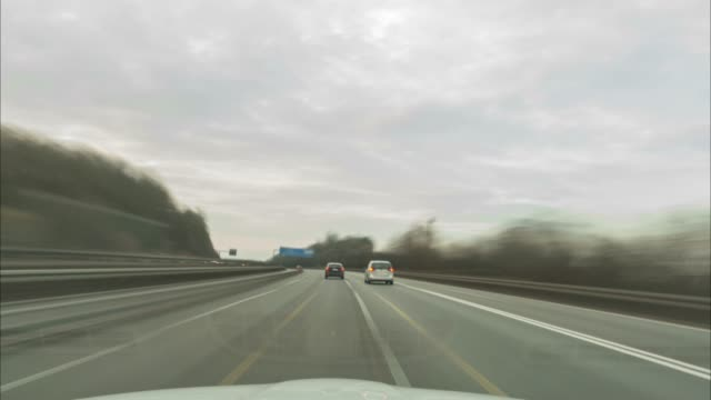 time lapse of a driving on the longest german autobahn a7 on the site between fulda and kassel. - autobahn video stock e b–roll