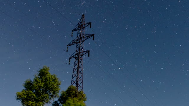 Time lapse of a electricity pylon in front of stars on sky. video