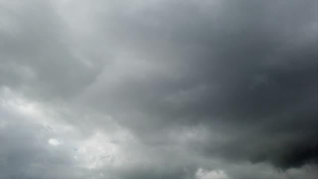 time lapse of a overcast stormy cloudy sky - passare davanti video stock e b–roll