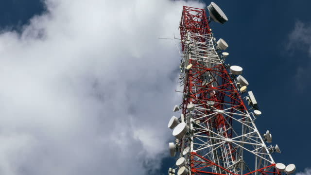 Time lapse of a telecommunication tower with moving cloud video
