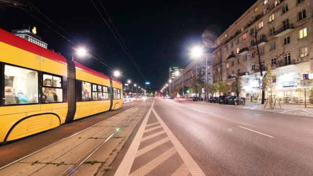 Time lapse of a trafficked road in Warsaw with trams in the night video