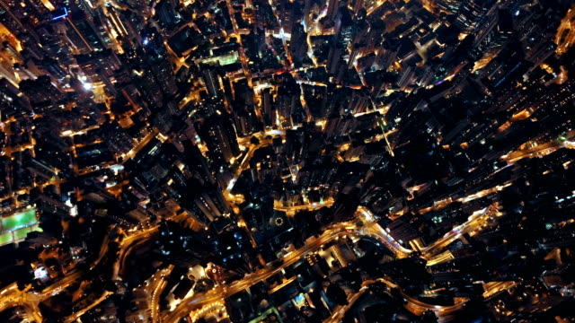 Time lapse of aerial view of Hong Kong Downtown, Republic of China. Financial district and business centers in smart city in Asia. Top view of skyscraper and high-rise buildings at night. Time lapse of aerial view of Hong Kong Downtown, Republic of China. Financial district and business centers in smart city in Asia. Top view of skyscraper and high-rise buildings at night. top garment stock videos & royalty-free footage