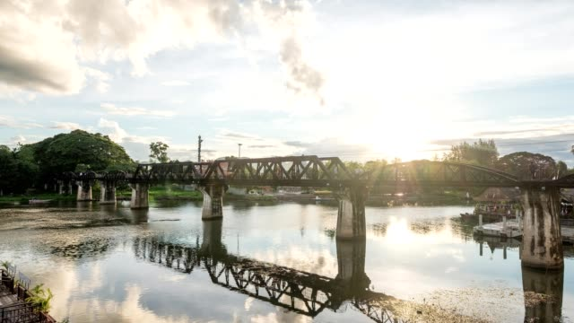 Time lapse of Ancient railway bridge with train running over in River Kwai video