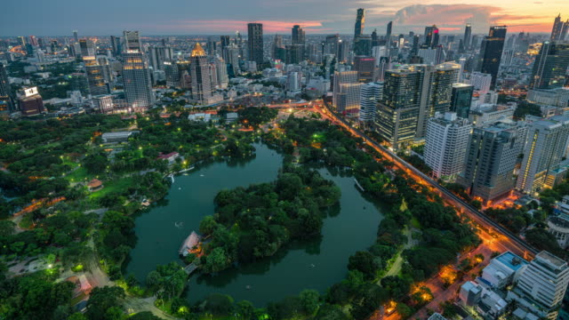 Time lapse of Bangkok cityscape and Lumpini park green space view, day to night Bangkok cityscape and Lumpini park green space view, day to night, 4k time lapse clip environmental conservation stock videos & royalty-free footage