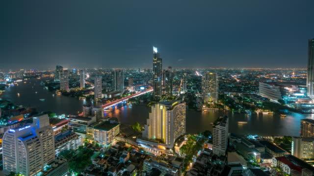 4k time lapse of bangkok skyline panorama and skyscraper in bangkok city downtown at chao phraya river bangkok thailand at night. - fiume chao phraya video stock e b–roll