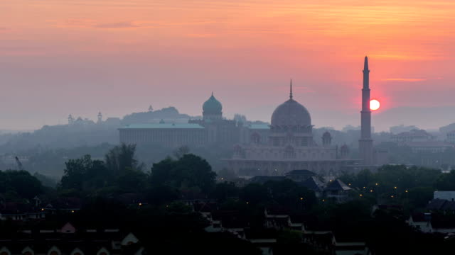 Time lapse of Beautiful hazy Sunrise At Putra Mosque video