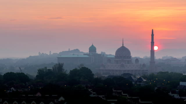 time lapse of beautiful hazy sunrise at putra mosque - eid mubarak stock videos and b-roll footage