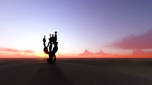 Time lapse of big sunrise over desert with silhouette of lone cactus in foreground 4k