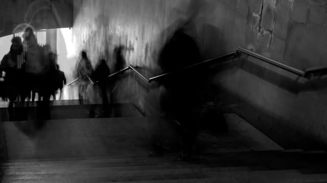 Time Lapse of black and white pictures of walking people on the stairs. FullHD video
