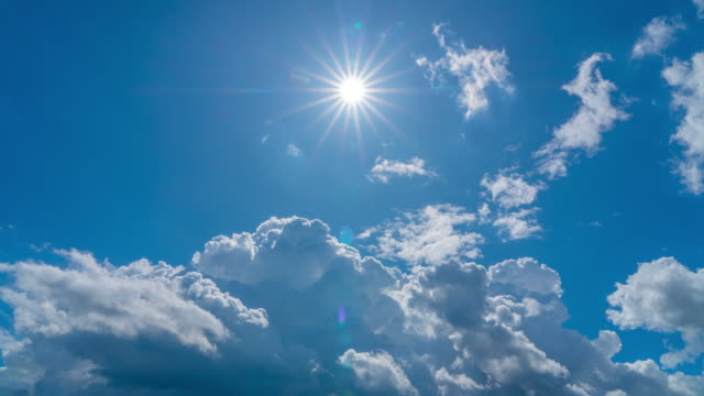 4K Time Lapse of Blue Sky Moving Cloudy with Sharp Sun rays in Summer