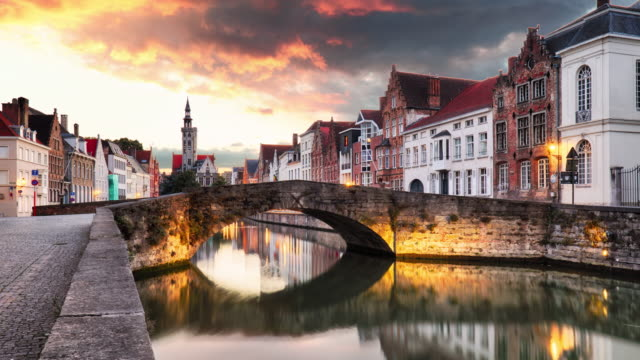 time lapse of bruges, belgium - scenic cityscape with canal spiegelrei - bruges video stock e b–roll