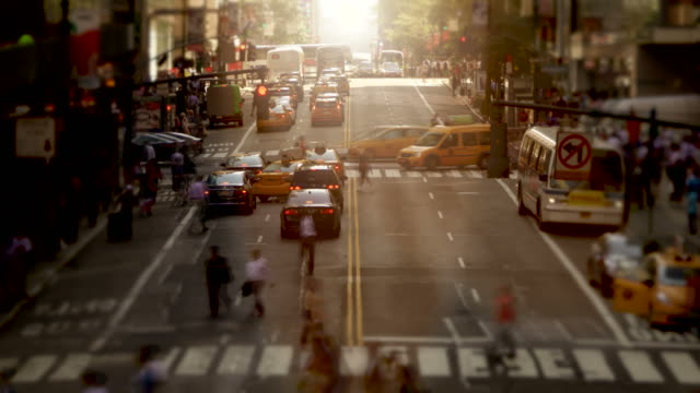 time lapse of busy city streets at rush hour. business people walking in new york city. symbolizing hecticness of modern life - landmarks stock videos and b-roll footage