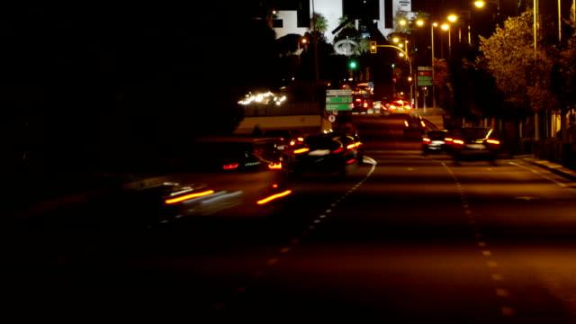time lapse of busy city traffic at night, alicante, costa blanca, spain - гладкая поверхность стоковые видео и кадры b-roll