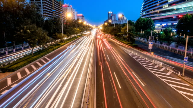 Time lapse of busy freeway traffic from day to night in beijing city,china video