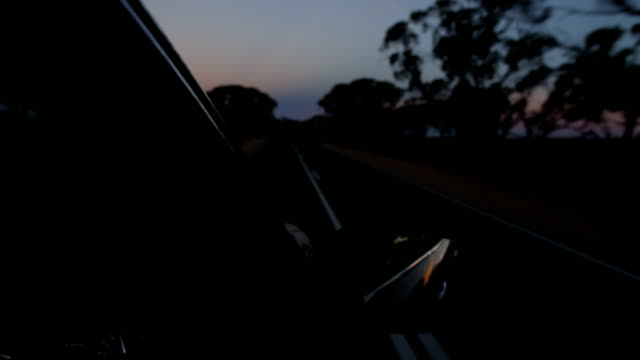 Time lapse of car driving (away from sunset) video