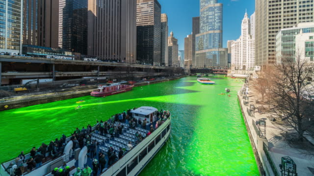 4K Time lapse of Celebrating St. Patrick's Day and dyeing Chicago river shades of emerald green in Chicago riverwalk, Illinois, United States, Irish culture and Tradition concept