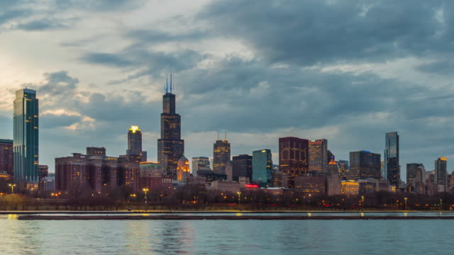 4K Time lapse of Chicago skyline panorama of Downtown Chicago with shoreline along Lake Michigan at beautiful sunset time in Chicago, Illinois, United States, Business and Modern Architecture concept