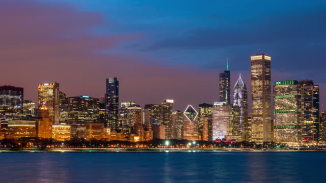 4K Time lapse of Chicago skyline panorama of Downtown Chicago with shoreline along Lake Michigan at beautiful nighttime in Chicago, Illinois, United States, Business and Modern Architecture concept