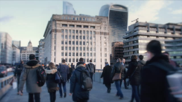 Time lapse of city commuters walking in winter, rear view. 12fps.