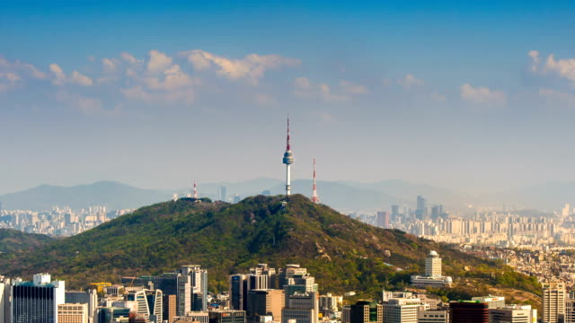 Time lapse of Cityscape in Seoul with Seoul tower and blue sky. Time lapse of Cityscape in Seoul with Seoul tower and blue sky, South Korea. gyeongbokgung stock videos & royalty-free footage