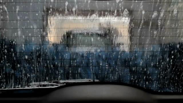 time lapse di pulizia auto a lavaggio - lucidare video stock e b–roll