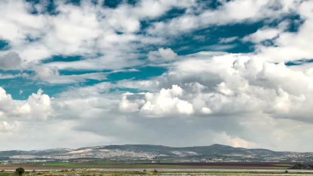 Time lapse of clouds in pure sky over the Galilee fields, Judea hills, Jerusalem, Israel video