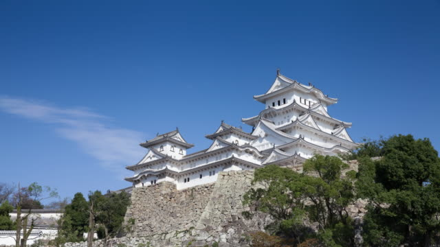Time lapse of clouds moving over the main tower and surrounding structures of Himeji Castle in Japan. It is a UNESCO World Heritage Site. video