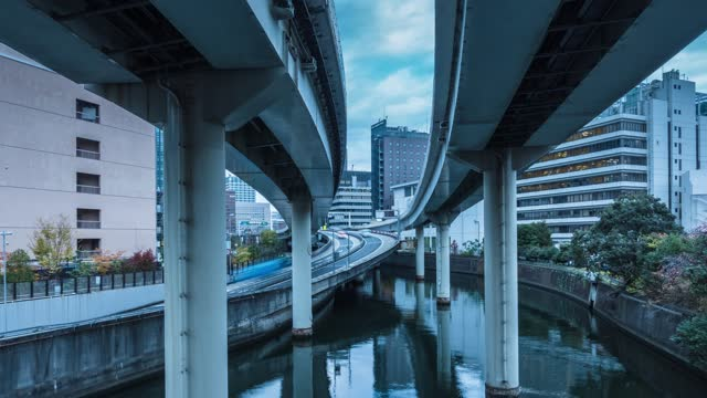 Time Lapse of clouds over highway and office buildings in Tokyo, Japan